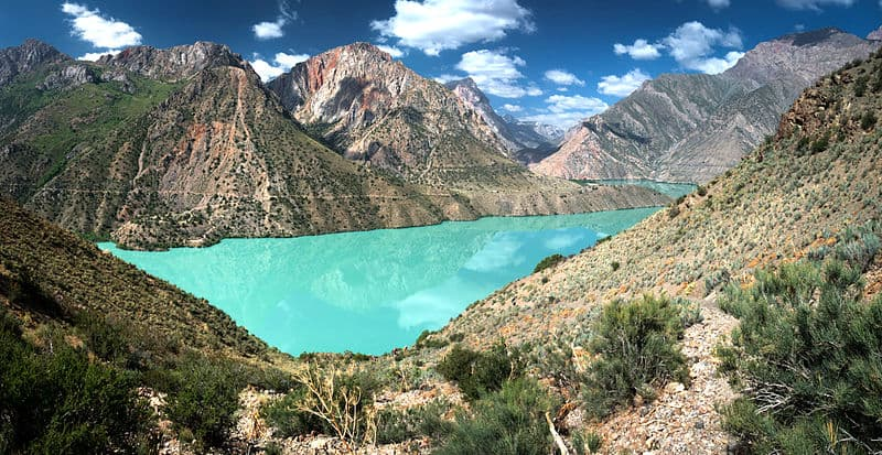 The Fann Mountains and a turquoise lake