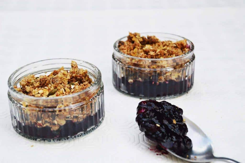 two jars of blueberry pudding and crumble dessert