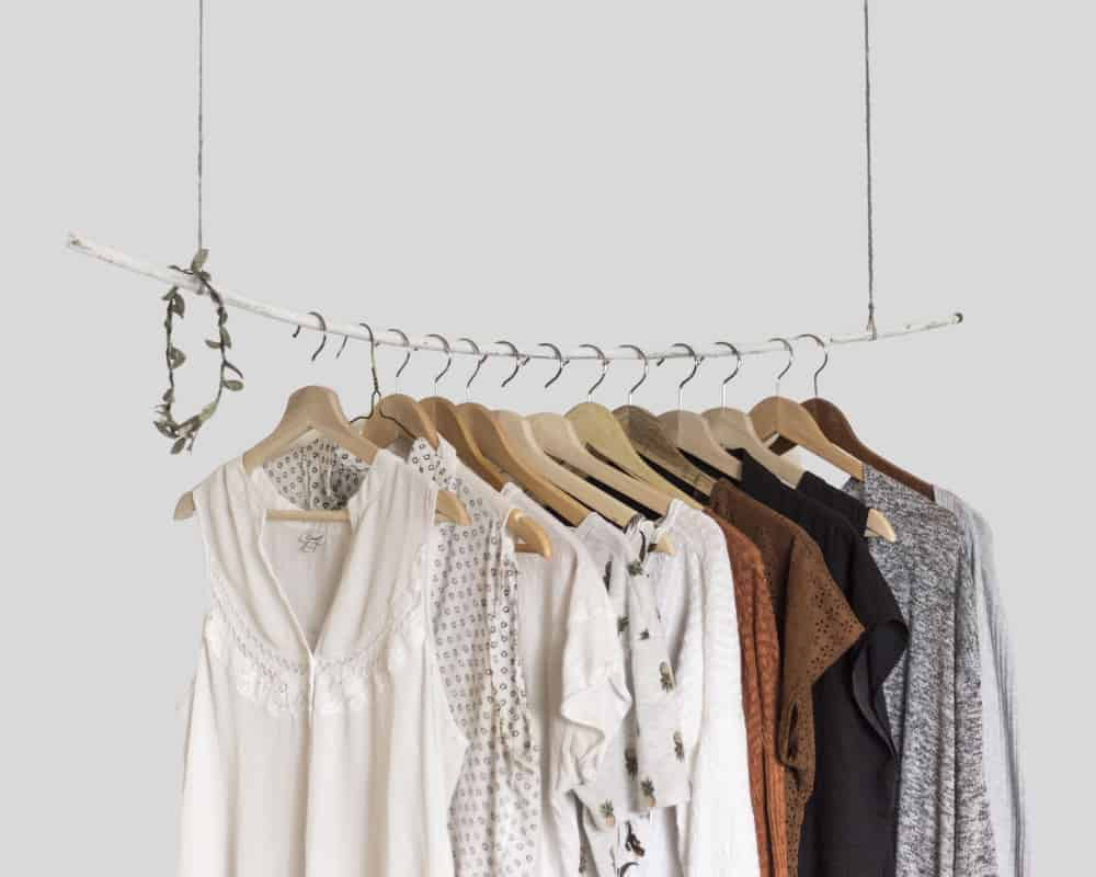 rack of various clothes and an olive branch