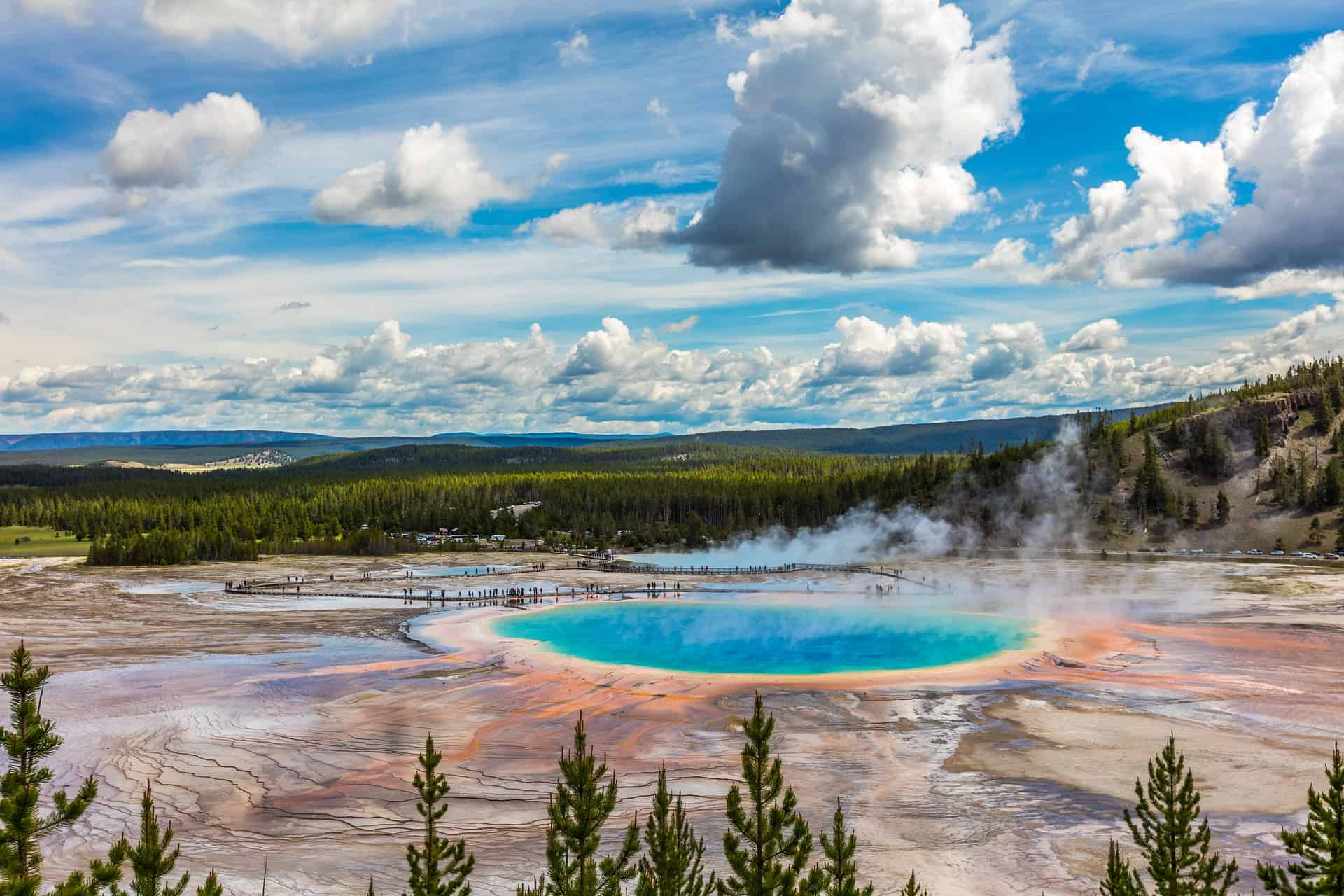 yellowstone national park landscape with a blue lake and clouds