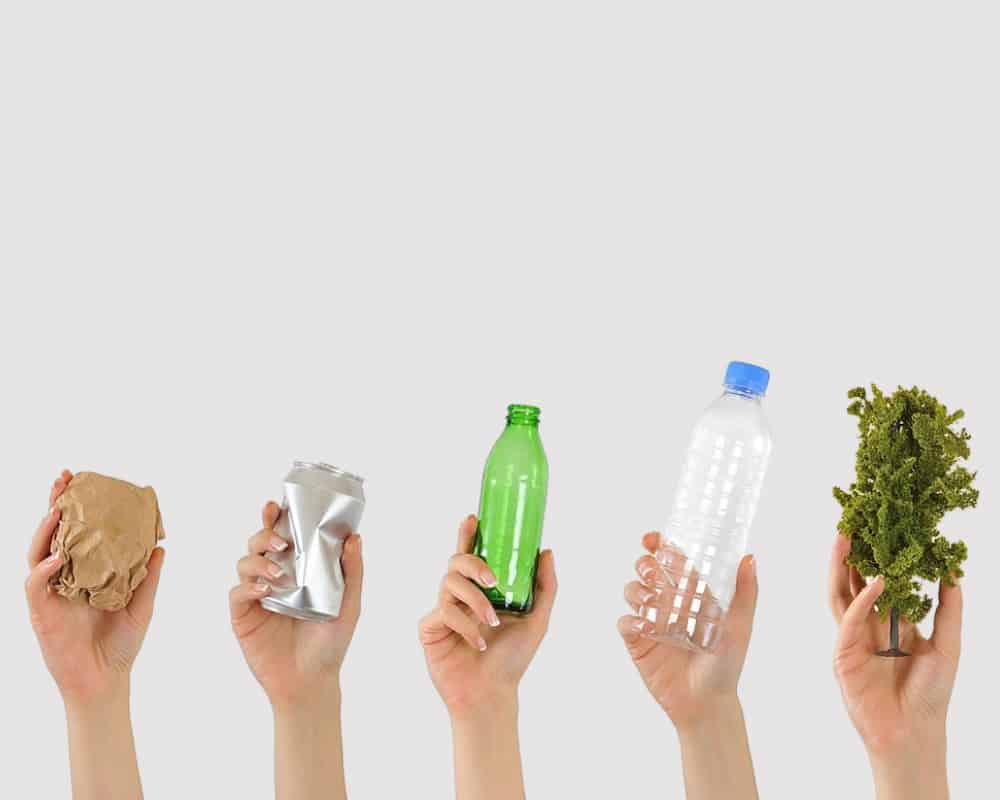 hands holding recyclable items